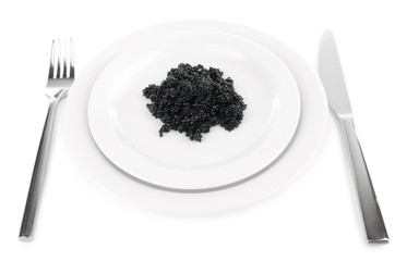 Black caviar on plate, fork and knife isolated on white