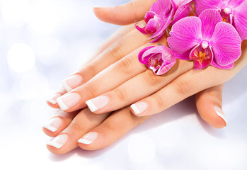 Fotobehang Manicure french manicure with orchids