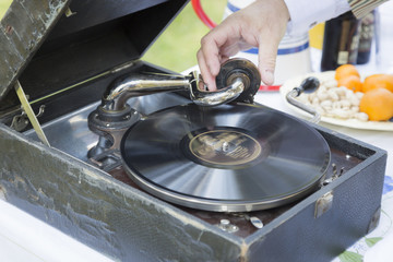 Man Starting Antique Phonograph Record Player