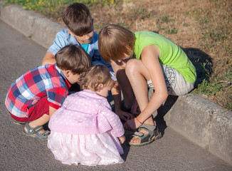 children drawing chalk on asphalt