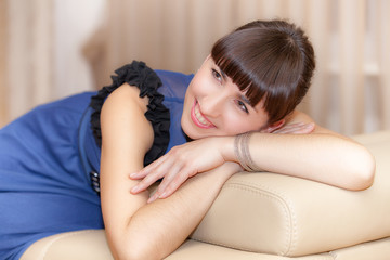 Portrait of a young woman on sofa