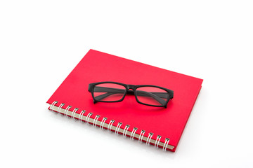 Red Diary Book with old glasses.