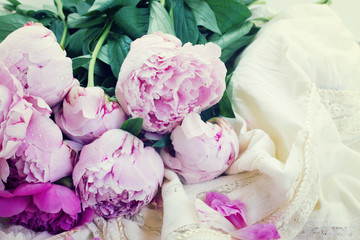 pink peonies and white wedding dress