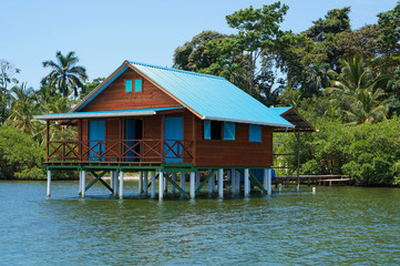 Bungalow on stilts over water of the Caribbean sea