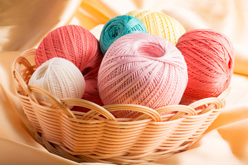 Colorful cotton yarn in the basket (close up shot)