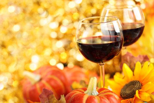 Autumn arrangement with wine, sunflowers and pumpkins.