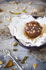 rustic muffin with pumpkin chocolate and oat flakes on bowl