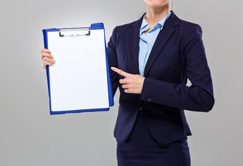 Businesswoman show with white paper of clipboard