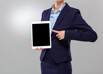 Businesswoman show with blank screen of digital tablet