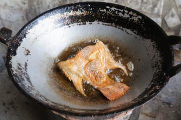 Deep fried half Tilapia fish fried