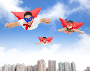 superman and daughters  flying in the sky