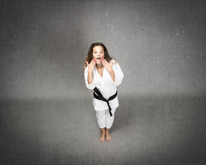 girl with unbelievable expression and karate uniform