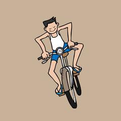 Boy rides bicycle