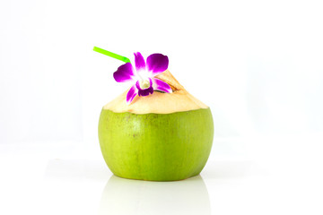 Coconut cocktail decorated purple orchid and straw