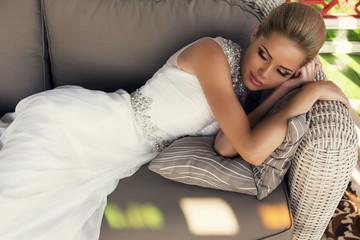 beautiful bride with blond hair in elegant wedding dress