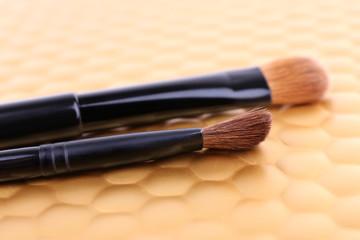 Brushes on golden background