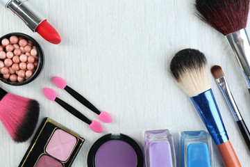 Beautiful decorative cosmetics and makeup brushes, isolated