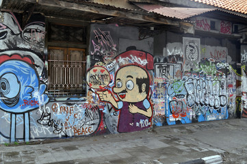 Street art graffiti on the wall in the street art in Yogyakarta