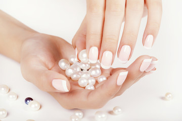 Wall Mural - Beautiful woman's nails with french manicure and pearls.