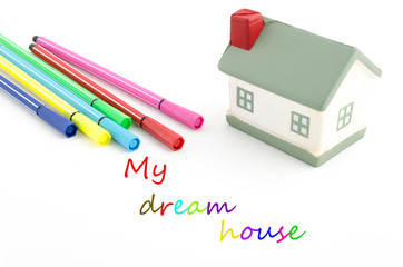 toy house with felt pens and text isolated on white