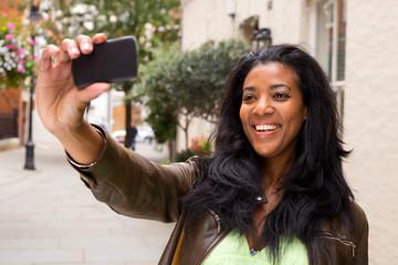 african american woman taking a selfie