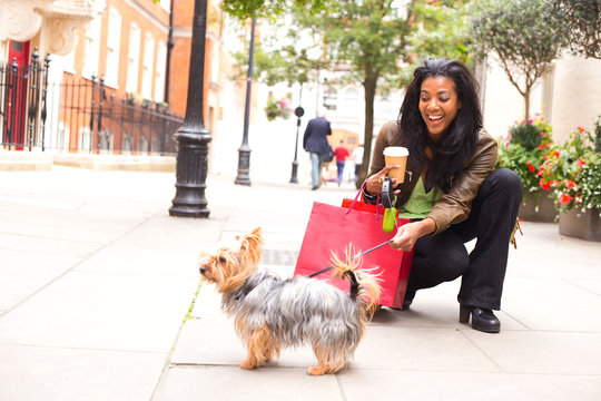 woman with dog and shopping bags.
