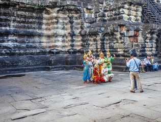 Apsara dancers performs for tourists at Angkor Wat temple