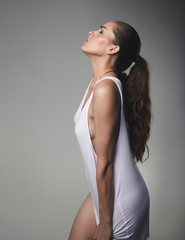 Sensual female model on grey background