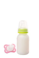 Baby pacifier and a bottle of baby formula milk