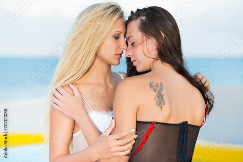 woman kissing another woman