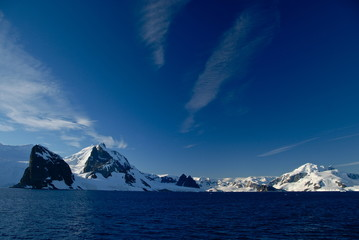 View of snowy mountains and ocean (Antarctica)