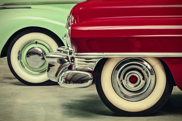 retro styled image of two vintage American cars