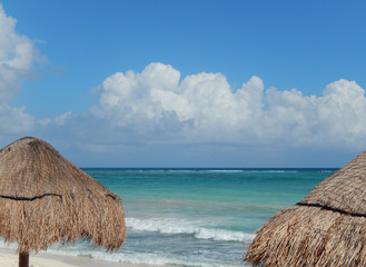 Caribbean beach with huts at the Atlantic