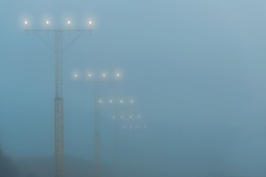 Landing lights at a airport during foggy weahter