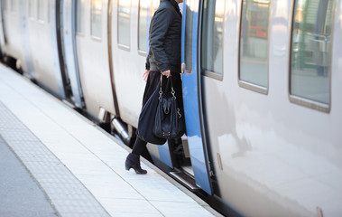 Woman in hurry enters train