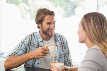 Happy couple enjoying a coffee