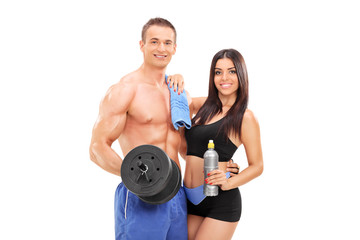 Attractive athletes posing with fitness equipment
