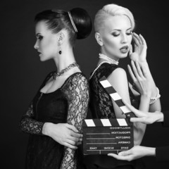 black and white photo of two sexy women in retro style