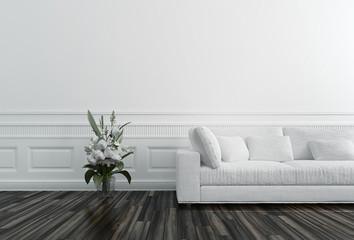 Flowers in Vase next to White Sofa
