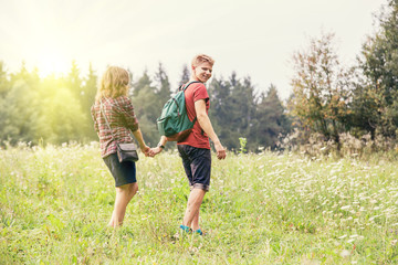 Young couple walks outdoor