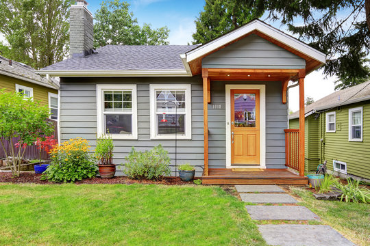 Grey old house with wooden trim