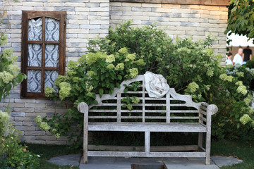 Wooden bench near house