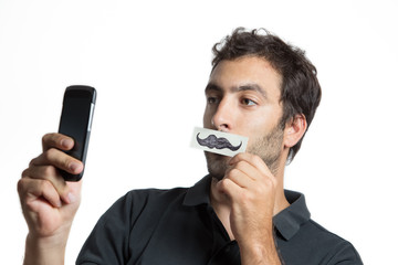 casual man make selfie portrait with fake moustache