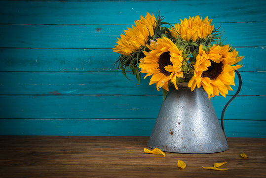 sunflower in metal vase