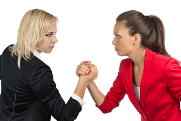 Arm wrestling of two businesswoman