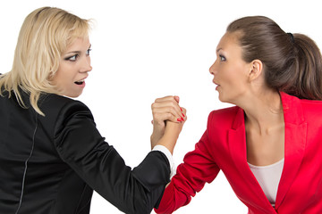 Arm wrestling of two smiling businesswoman