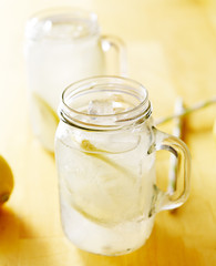 homemade lemonade in mason jar with straws to the side