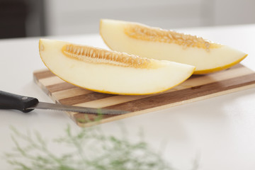 Melon on cutting board