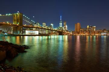 Spoed Foto op Canvas New York City Brooklyn Bridge with lower Manhattan skyline at night