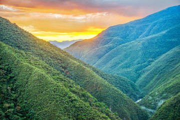 Sunrise over Jungle Covered Hills